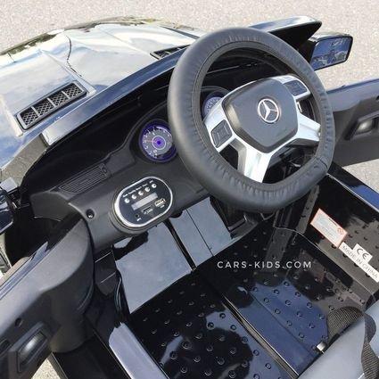 Электромобиль Mercedes Benz ML350 черный (резиновые колеса, кожа, пульт, музыка, глянцевая покраска)